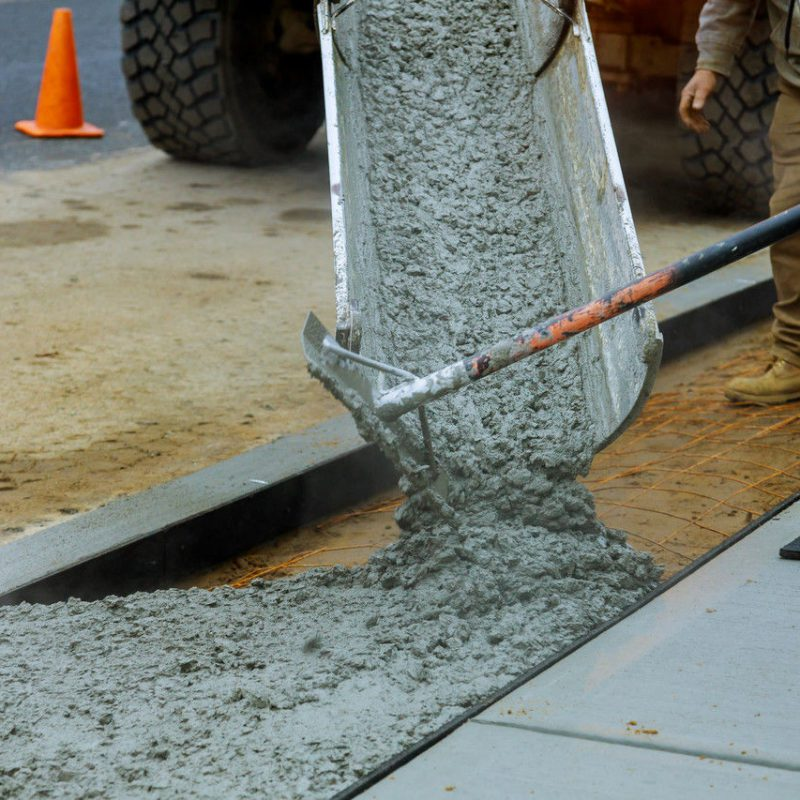 Worker working for concrete pavement for ground flooring at construction